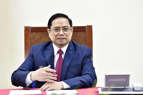 Thủ tướng Phạm Minh Chính điện đàm với Thủ tướng Quốc vụ viện Trung Quốc - Ảnh 1.
