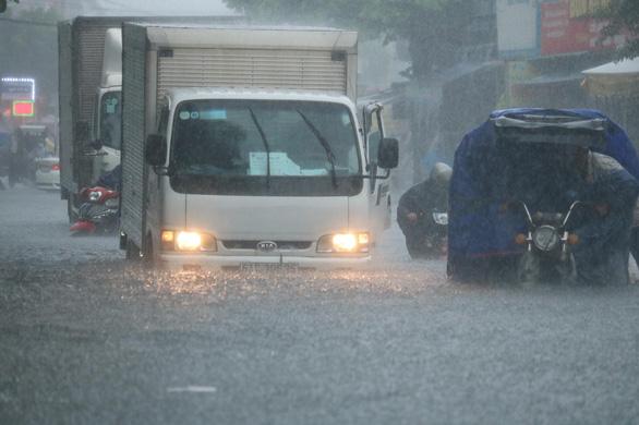 Hôm nay Nam Bộ có mưa diện rộng, miền Tây rả rích cả ngày - Ảnh 1.
