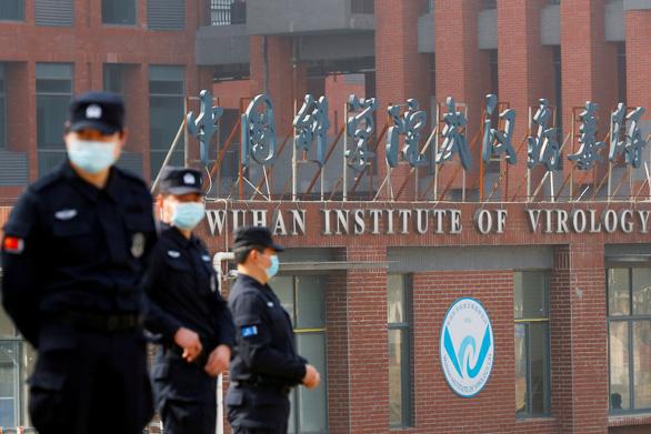 Trung Quốc so sánh rò rỉ virus corona với cáo buộc vũ khí hủy diệt ở Iraq - Ảnh 1.