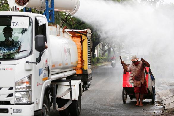 Indonesia đang rơi vào đợt bùng dịch COVID-19 tồi tệ nhất từ trước đến nay - Ảnh 1.