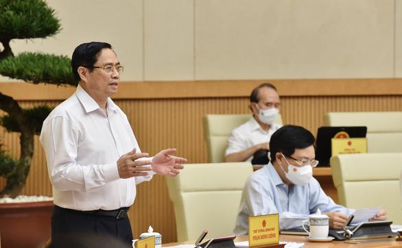 Thủ tướng Phạm Minh Chính: Chưa thay đổi mục tiêu kép như đã đề ra - Ảnh 1.