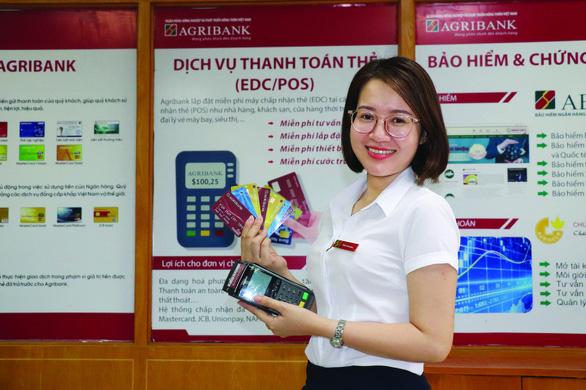 Agribank và các giải pháp thanh toán không dùng tiền mặt - Ảnh 1.