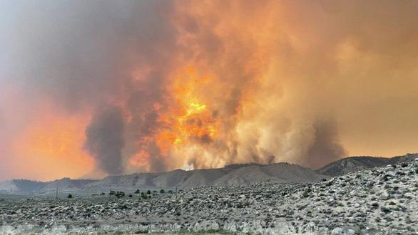 Nắng cháy ở Tây Mỹ, Canada kéo dài đến hết 12-7 mới giảm - Ảnh 1.