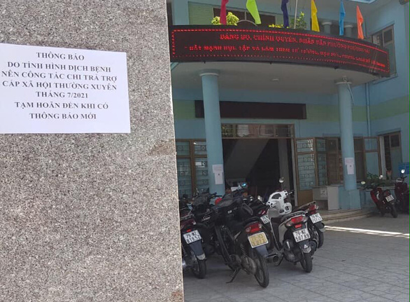 Vì sao chậm trả tiền trợ cấp xã hội cho người già, người khuyết tật ở Nha Trang? - Ảnh 1.