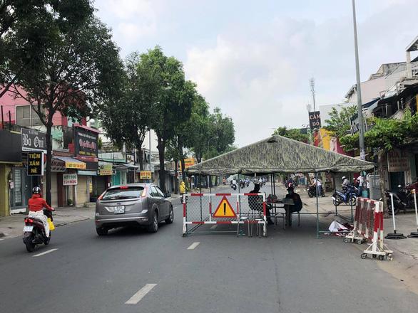 Dời chốt ở đường Nguyễn Kiệm, nới lỏng kiểm tra qua các chốt ở Gò Vấp - Ảnh 1.