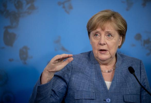 Đức không ép, muốn dân tin và tự nguyện tiêm vắc xin - Ảnh 1.