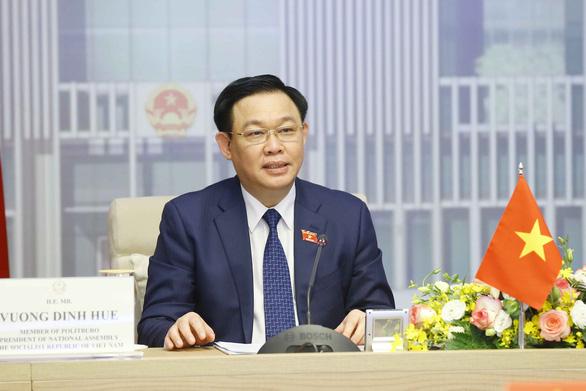 Việt Nam đề nghị chia sẻ kinh nghiệm tiếp cận vắc xin và công nghệ với Singapore - Ảnh 1.