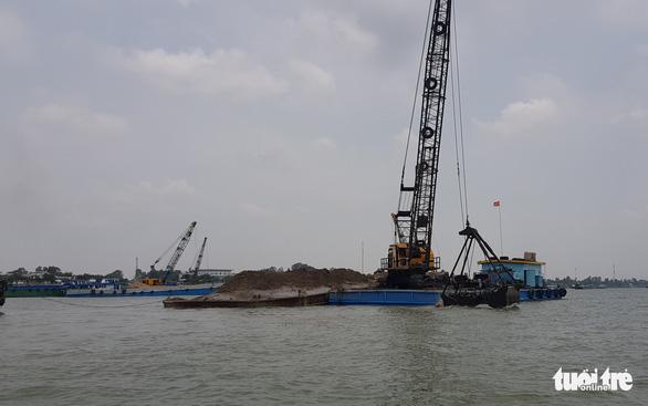 Doanh nghiệp trúng đấu giá mỏ cát trên sông Hậu đã nộp hơn 50 tỉ đồng - Ảnh 1.
