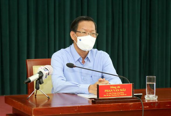 Ông Phan Văn Mãi: Giãn cách thêm 1 tháng để từng bước đưa TP.HCM về bình thường mới - Ảnh 1.