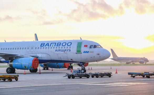 Từ 22-7 chỉ còn 2 chuyến bay khứ hồi mỗi ngày giữa TP.HCM và Hà Nội - Ảnh 1.