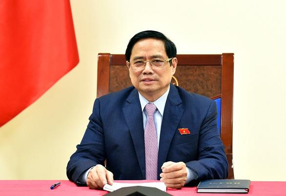 Lãnh đạo Việt Nam, Philippines bàn về Biển Đông và phối hợp tiếp cận vắc xin COVID-19 - Ảnh 1.