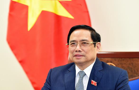 Thủ tướng đề nghị Hàn Quốc tiếp tục hỗ trợ Việt Nam nhận vắc xin qua COVAX - Ảnh 1.