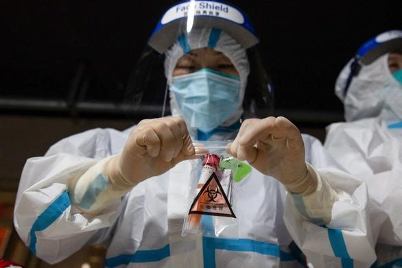 Xuất hiện các ca nhiễm đột phá tại Trung Quốc - Ảnh 1.