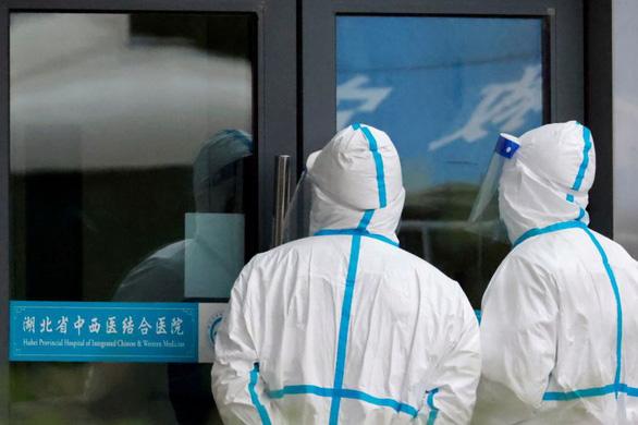 Bị Trung Quốc bác, WHO thúc tất cả các nước hợp tác điều tra nguồn gốc COVID-19 - Ảnh 1.