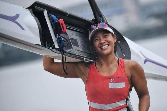 Cô y tá vừa chữa trị bệnh nhân COVID-19 vừa tập luyện để tranh tài ở Olympic Tokyo - Ảnh 1.