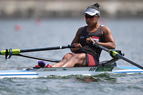 Cô y tá vừa chữa trị bệnh nhân COVID-19 vừa tập luyện để tranh tài ở Olympic Tokyo - Ảnh 2.