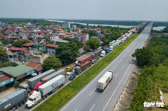 NÓNG: Chính phủ gỡ lưu thông hàng hóa, không kiểm tra xe chở hàng có QR từ 0h ngày 30-7 - Ảnh 1.