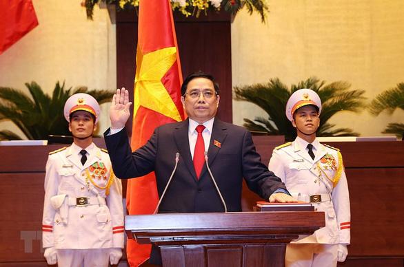 Lãnh đạo Trung Quốc, Lào chúc mừng Chủ tịch nước và Thủ tướng Chính phủ - Ảnh 1.