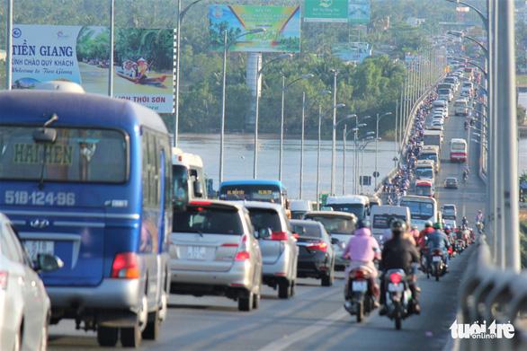 Bến Tre dự kiến đón 1.400 người dân ở TP.HCM về quê từ 30-7 - Ảnh 1.