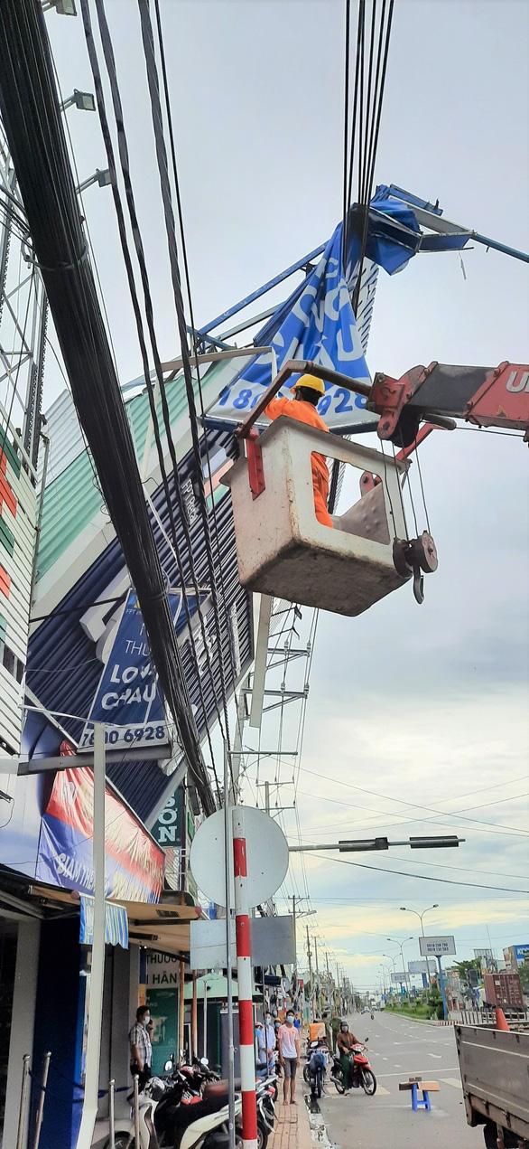 EVNSPC khuyến cáo sử dụng điện an toàn mùa mưa bão - Ảnh 1.