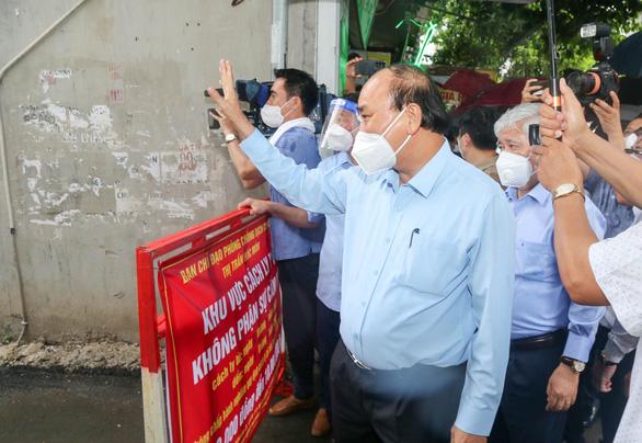 Chủ tịch nước Nguyễn Xuân Phúc yêu cầu Bộ Y tế cấp phép sớm cho vắc xin Nano Covax - Ảnh 1.