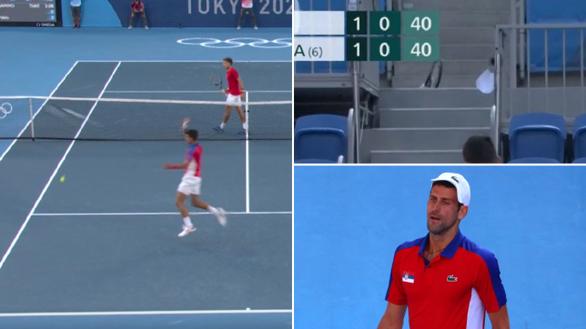 Thua trận, Djokovic nổi điên đập vợt và ném vợt lên khán đài - Ảnh 1.