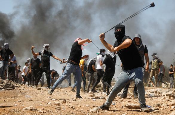 Israel không kích trả đũa 2 điểm của Hamas ở dải Gaza - Ảnh 1.