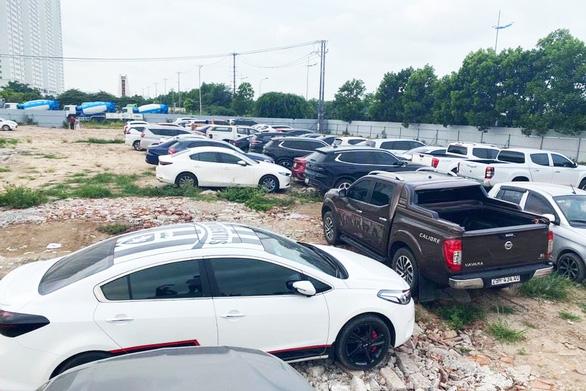 Đường dây tiêu thụ ôtô trộm cắp, cầm cố 'siêu khủng', công an thu giữ gần 100 xe - Ảnh 1.