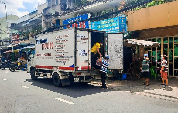 Xe anh Minh lên đường, chở yêu thương từ mọi miền về TP.HCM - Ảnh 1.