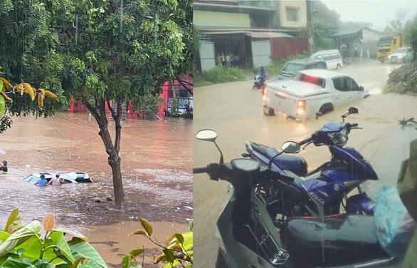 TP Lào Cai mưa lớn, nhiều ôtô chìm trong nước - Ảnh 6.