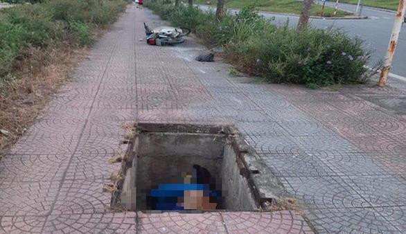 Điều tra vụ người đàn ông chết dưới hố cáp ngầm - Ảnh 1.