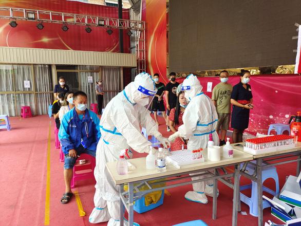 Trung Quốc có ca nhiễm cao nhất trong nửa năm, phát hiện biến thể Delta lần 2 - Ảnh 1.