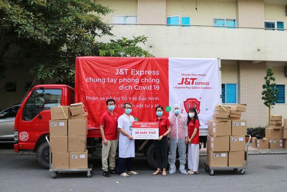 Nỗ lực vượt khó cùng người lao động của J&T EXPRESS trong mùa dịch - Ảnh 3.