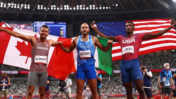 VĐV Ý vô địch nội dung chạy 100m tại Olympic 2020 - Ảnh 1.