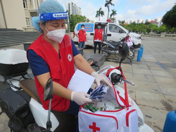 TP Thủ Đức đưa các đội tiêm vắc xin lưu động đến từng khu phố - Ảnh 1.