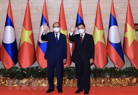 Chủ tịch nước Nguyễn Xuân Phúc: Quan hệ Việt - Lào cao hơn các hiệp định, hiệp ước - Ảnh 1.