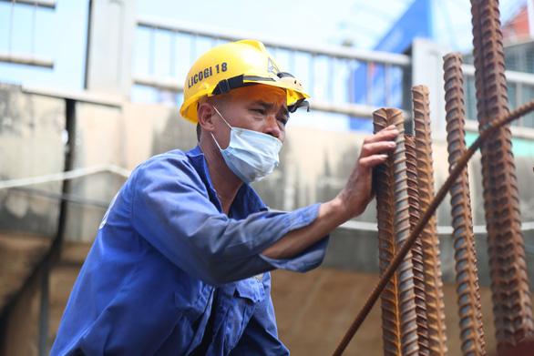 Hà Nội công khai số đường dây nóng 0243.834.4643 hỗ trợ gói 26.000 tỉ đồng - Ảnh 1.