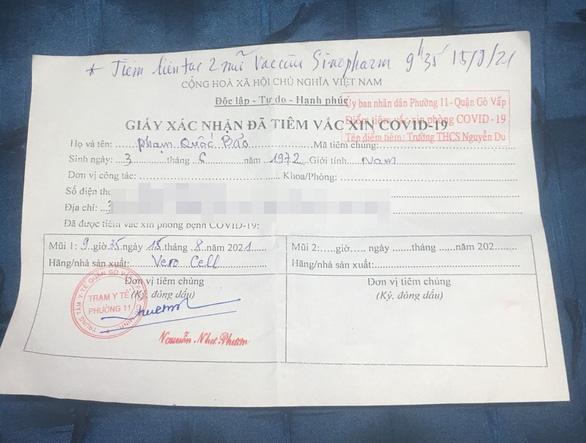 Chưa đầy 1 phút, người đàn ông 49 tuổi ở TP.HCM tiêm 2 mũi vắc xin Vero Cell - Ảnh 1.