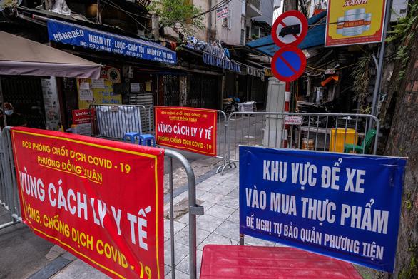 Một người ở Hà Nội chết trong tư thế treo cổ, xét nghiệm phát hiện mắc COVID-19 - Ảnh 1.