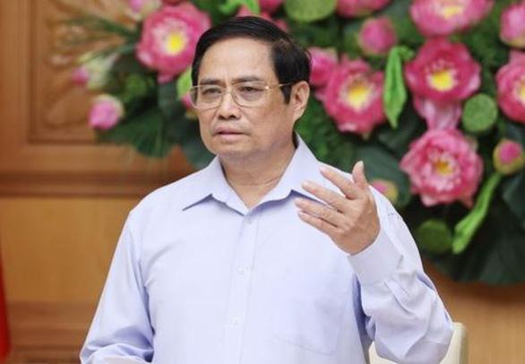Thủ tướng khuyến khích các địa phương, đơn vị tìm mua vắc xin phòng COVID-19 - Ảnh 1.
