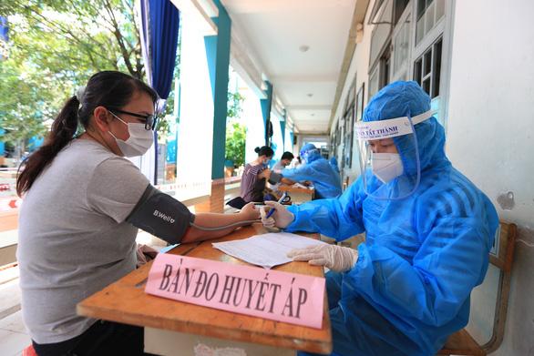Hơn 5 triệu người ở TP.HCM đã được tiêm vắc xin - Ảnh 1.
