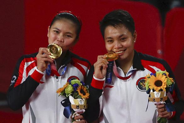 Đánh bại đôi Trung Quốc, Indonesia giành HCV cầu lông Olympic - Ảnh 2.
