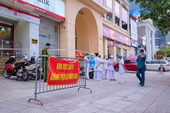 Hà Nội khẩn cấp tìm người có liên quan Công ty thực phẩm Thanh Nga - Ảnh 1.