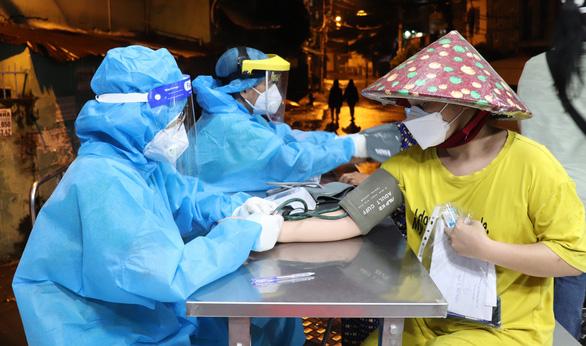 TP.HCM: Những ai được tiêm vắc xin mũi 2 đến ngày 15-9? - Ảnh 2.
