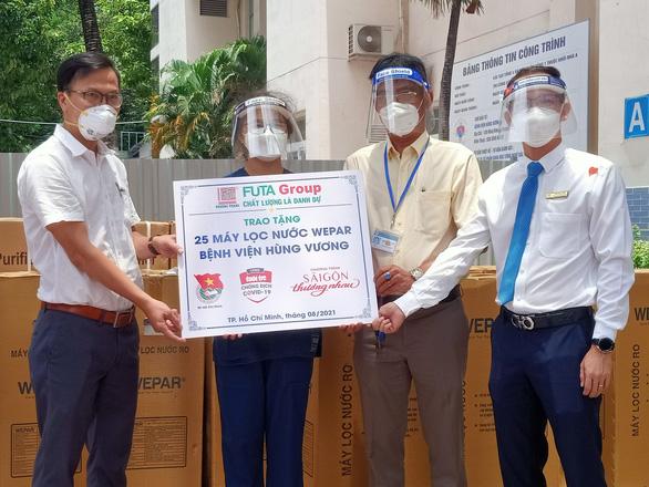 Tặng 75 máy lọc nước cho 3 Bệnh viện Nguyễn Tri Phương, Nguyễn Trãi và Hùng Vương - Ảnh 3.