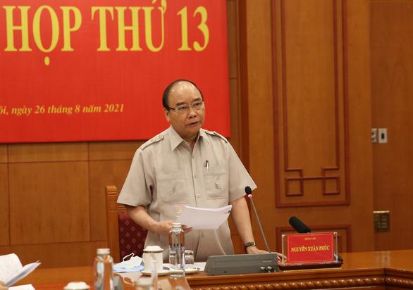 Chủ tịch nước Nguyễn Xuân Phúc: Phiên tòa xét xử trực tuyến là tất yếu - Ảnh 1.
