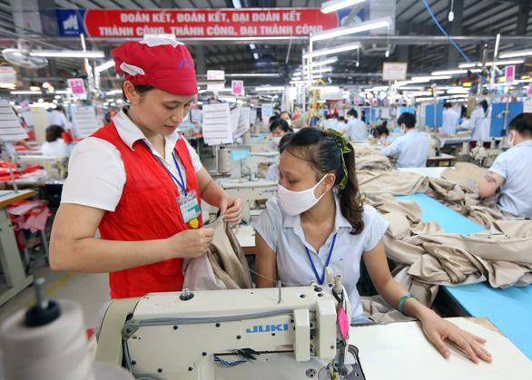 Xuất khẩu hưởng lợi nhiều tỉ USD từ EVFTA và CPTPP - Ảnh 1.