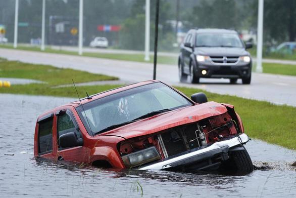 Bão Ida nhấn chìm bờ biển bang Louisiana - Ảnh 6.