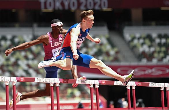 Cuộc đua huy chương Olympic: Vì sao đoàn Mỹ chậm chạp? - Ảnh 1.