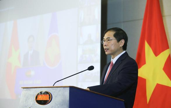 Kỷ niệm 54 năm thành lập ASEAN, Bộ Ngoại giao tổ chức lễ chào cờ đặc biệt - Ảnh 1.